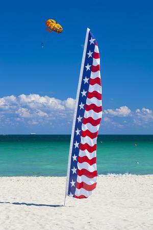 Flag and parachute on the beach