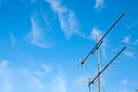 antennas: Antennas home TV on blue sky Stock Photo