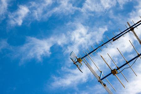 Antennas home TV on blue sky Stock Photo