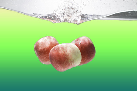 retro backgrounds: apples drop in the water  and air bubbles over white background presentations