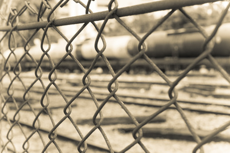 barbed wire fence: Barbed Wire Fence. Prison Fence in Black and White Closeup.