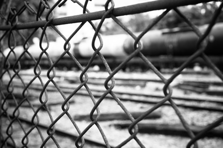 Barbed Wire Fence. Prison Fence in Black and White Closeup.