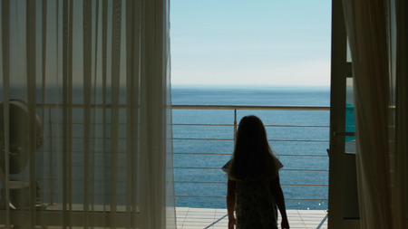guest room: Mom and daughter go to the balcony with the amazing sea view from the guest room Stock Photo