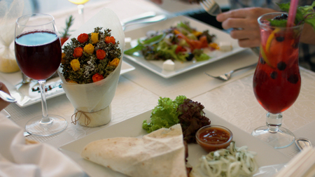 Appetizing and tasty meal of the friendly family in the cafe