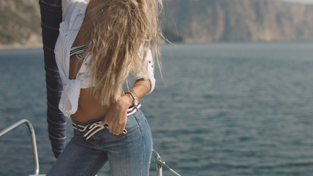 Very beautiful, sensual sexy blonde girl on the yacht