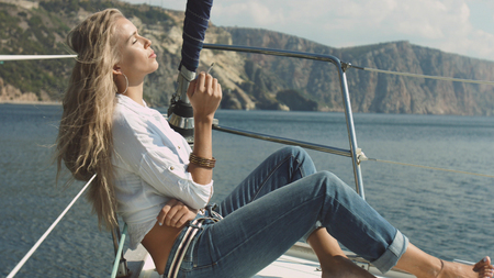 Sexy girl smokes on the yacht