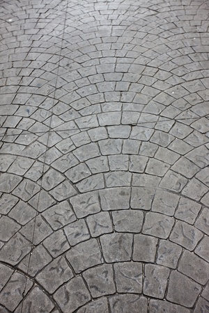 The shot of Typical Paving Pattern using square stones. photo