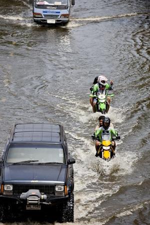 decades: Bangkok, Thailand - November 5, 2011: Traffic in Bangkok during the worst flooding in decades.