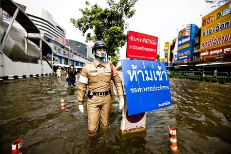Bangkok, Thailand - November 5, 2011: The Police Status standing during the flooding in Bangkok.