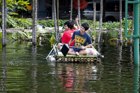 Bangkok, Thailand - November 5, 2011: How People travel during the flooding in Bangkok.
