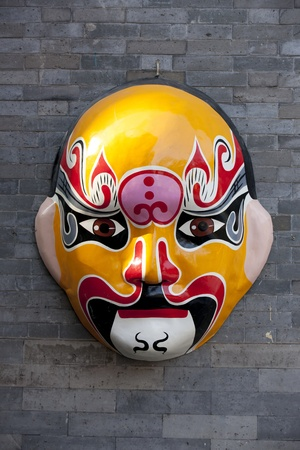 Traditional Chinese Mask Hanging on the wall in Beijing   photo