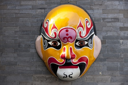 chinese opera: Traditional Chinese Mask Hanging on the wall in Beijing