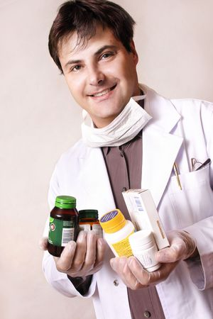 Doctor holding a variety of medicines and supplements Stock Photo