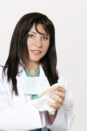 Young female doctor cleaning hands