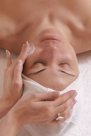 Little bit of luxury - Beauty or skincare consultant applying lotion. Stock Photo - 219576