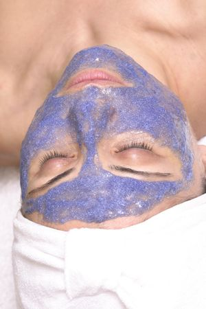 Woman with facial treatment Stock Photo