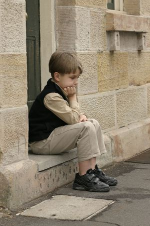 glum: Dejected boy Stock Photo