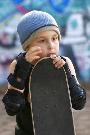 defamation: A boy with his skateboard waits his turn