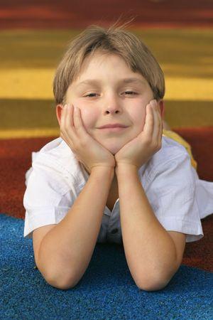 Boy on playground matting. photo