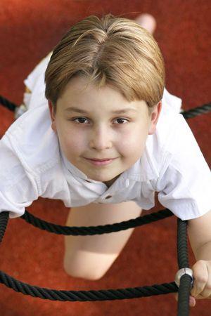 Boy on ropes photo
