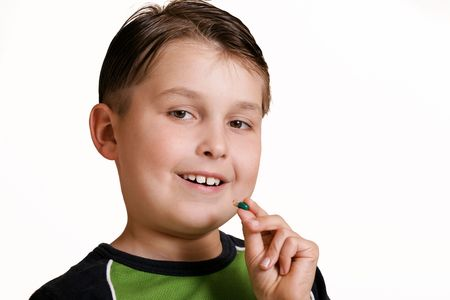 medicate: Boy with capsule Stock Photo
