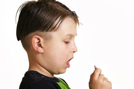 Boy taking medicine Stock Photo