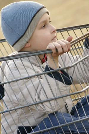 scallywag: Child sitting in a trolley Stock Photo