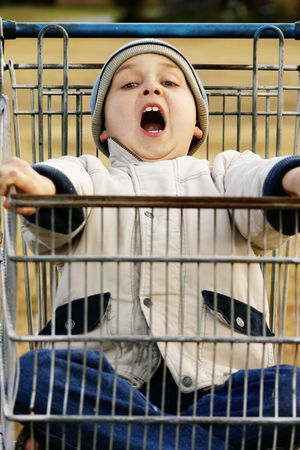 scallywag: Boy in a beat up old trolley, having fun Stock Photo