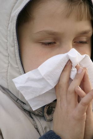 hayfever: Child blowing nose and looking unwell Stock Photo