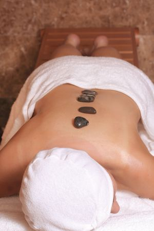 Relaxing Hot Rocks Treatment... helping to loosen tight muscles, relieve stress and ease tension