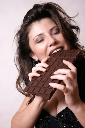 glutton: Chocoholic:  Woman with a large block of chocolate Stock Photo