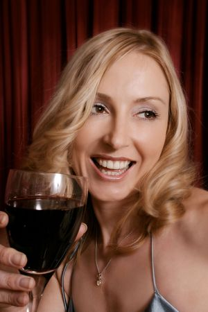 tipsy: Happy girl with glass of wine