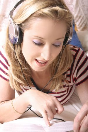 Listening to music and reading the cd jacket Stock Photo - 233501