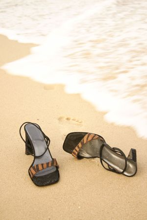 kick off: Kick off Your Heels - Sandals on seashore