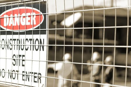 fencing wire: Sign and construction workers Stock Photo