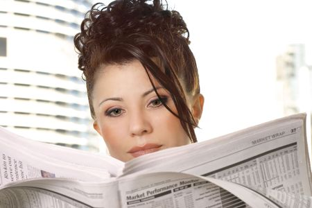 Businesswoman reviewing financial markets, stocks, money, business photo