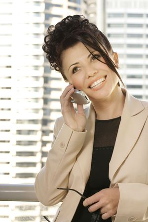 A woman talking business and smiling. Stock Photo