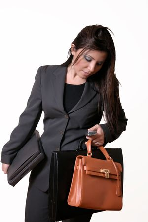 Busy working woman juggles with bags, laptop and cellphone. photo