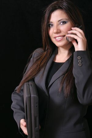 solicitor: Wireless working girl with cellphone and laptop. Stock Photo
