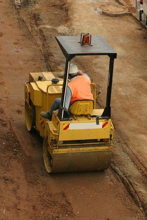 Construction:  Man using a steamroller