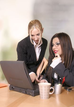 Two colleagues work and discuss business matters Stock Photo