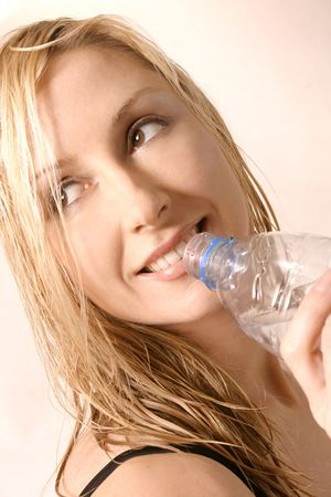 hydrate: Hydrate 2 - Happy woman with water bottle Stock Photo