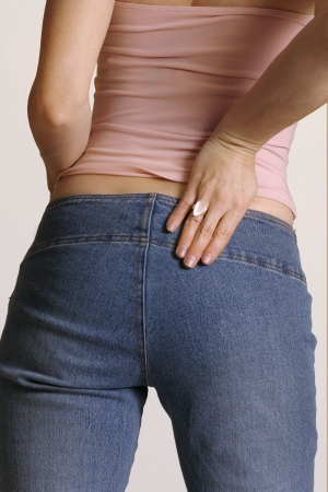 Girl in Jeans showing firmly toned buttocks and thighs  -  behind view Stock Photo - 255157