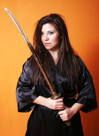 dual: Dual - Female holding a sword. Stock Photo