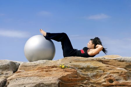 crunches: Abs crunches,   Using a pilates ball Stock Photo