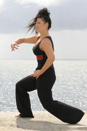 Tai Chyi - Gracefully moving through a set of movements. photo