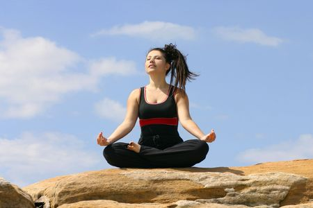 solace: Meditating outdoors Stock Photo