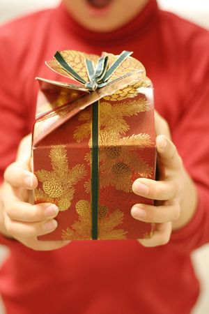 Giving gifts at Christmas.  Focus on the gift Stock Photo