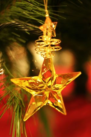 Christmas Star - Golden star hanging on Christmas tree.