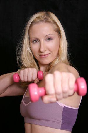 vigor: Weights workout against a dark background